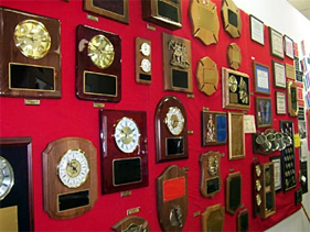 wall of awards and plaques at Dottie's Trophies Showroom in Laurel, Maryland